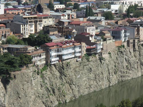 Tbilisi river cliff houses
